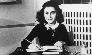 Anne Frank with her diary
