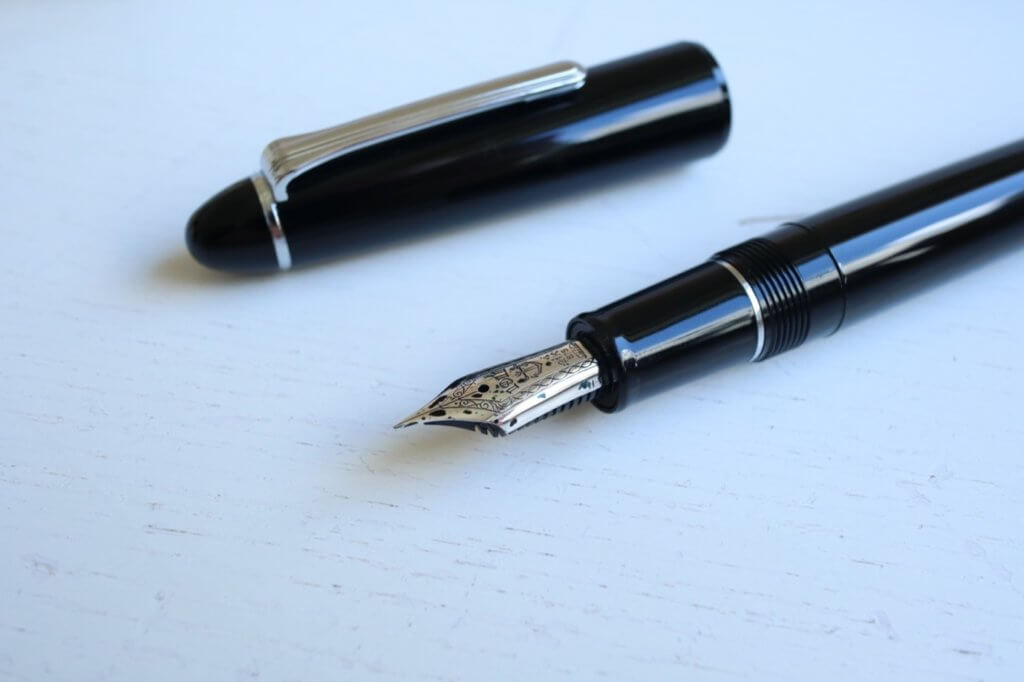 The nib and cap of the Sailor 1911 Ringless fountain pen in Simply Black