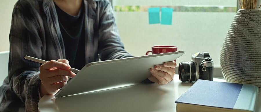 An artist using a stylus on a tablet.