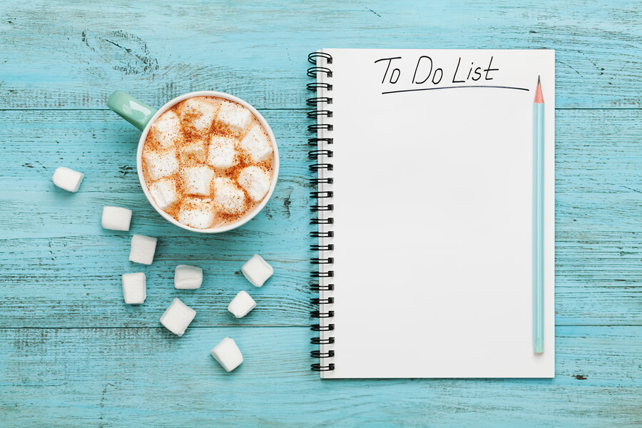 A to-do list with a hot chocolate