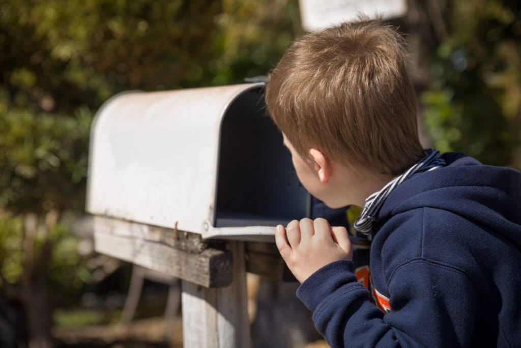 Boy awaiting a letter