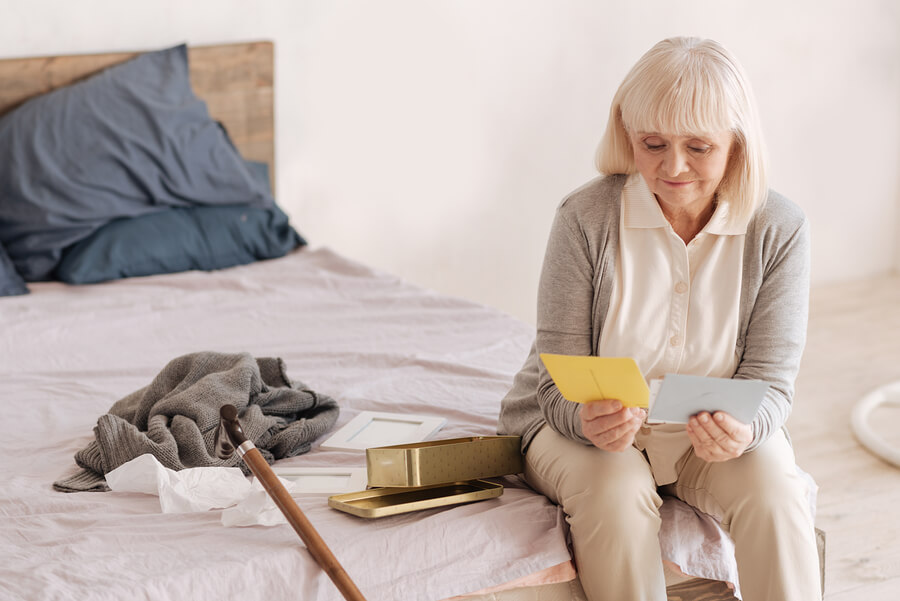 An older lady reading old letters