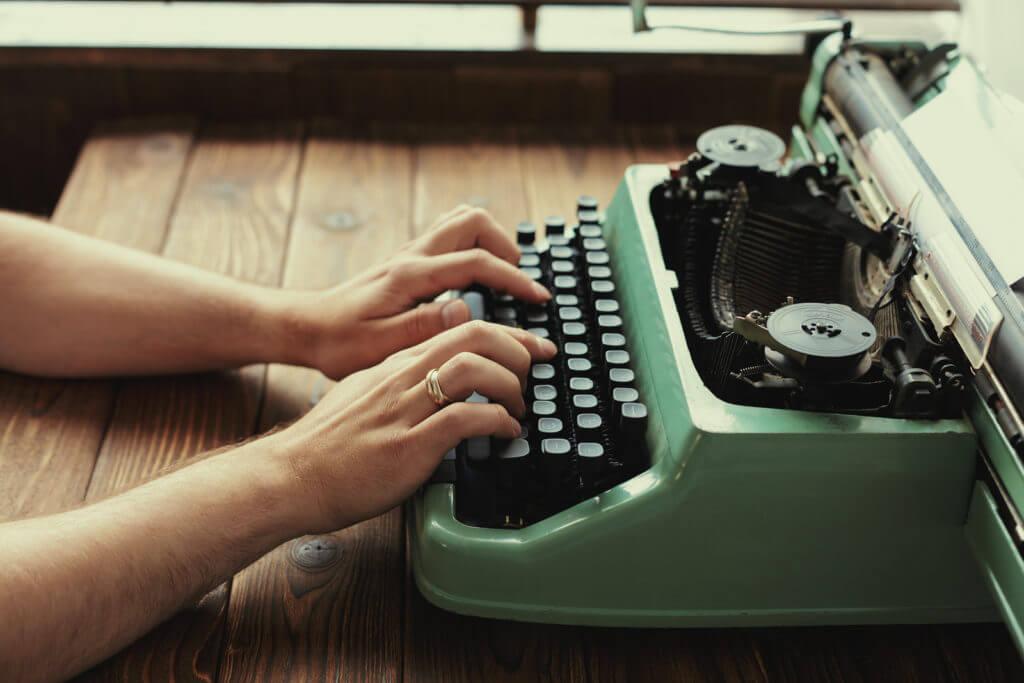 Typing on a vintage typewriter