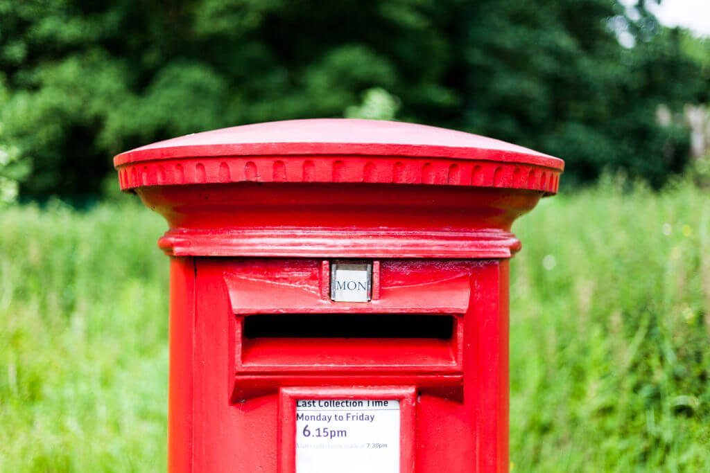 A red Royal Mail postbox
