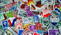 How are British postage stamps designed?