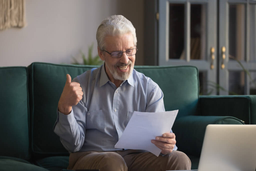 older person reading snail mail