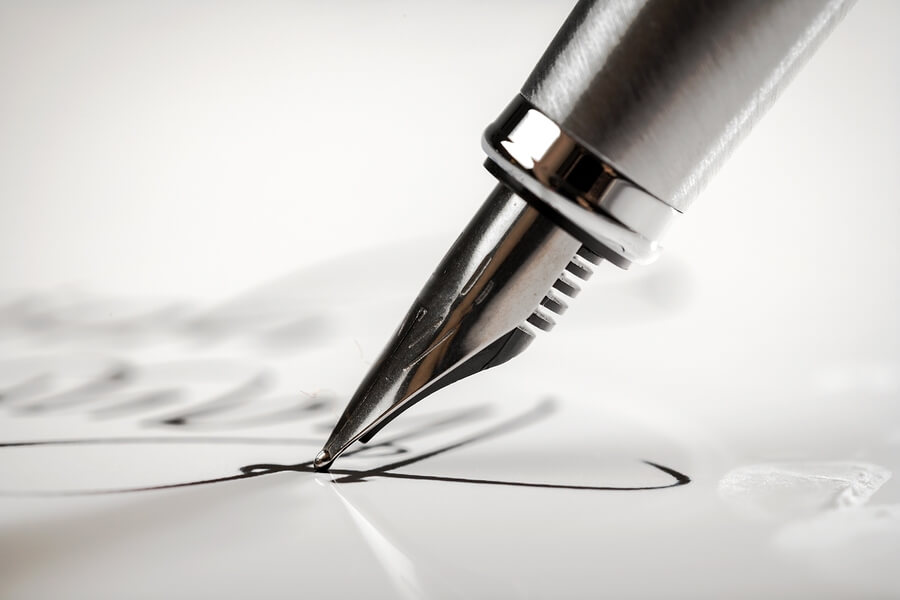 A pen performing a signature
