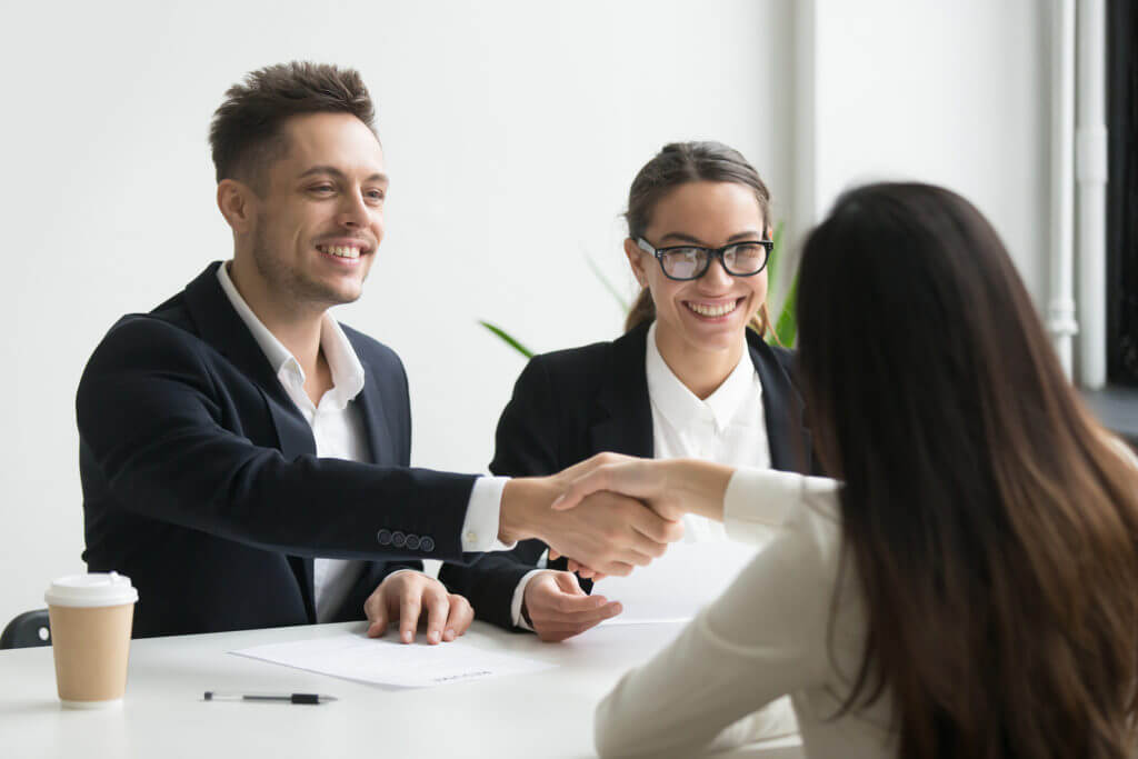 Applicant getting the job in an interview after perfect cover letter