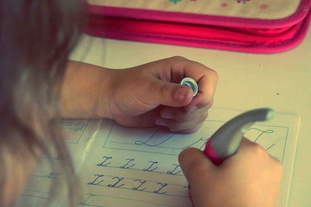 A child writing with a pen