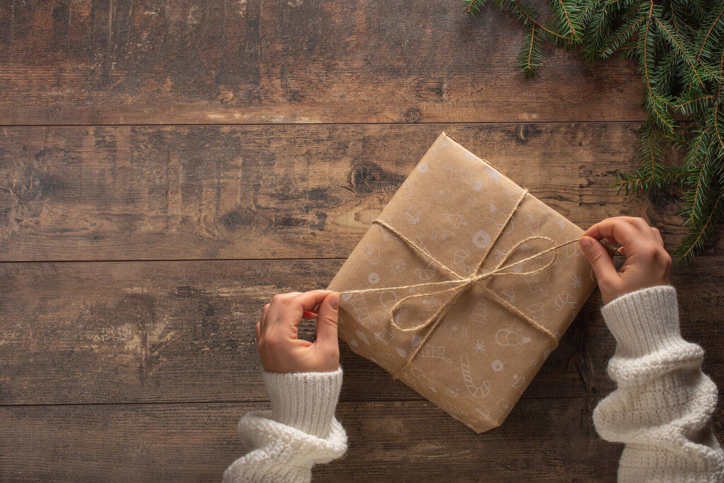 A Christmas gift wrapped in brown paper and string