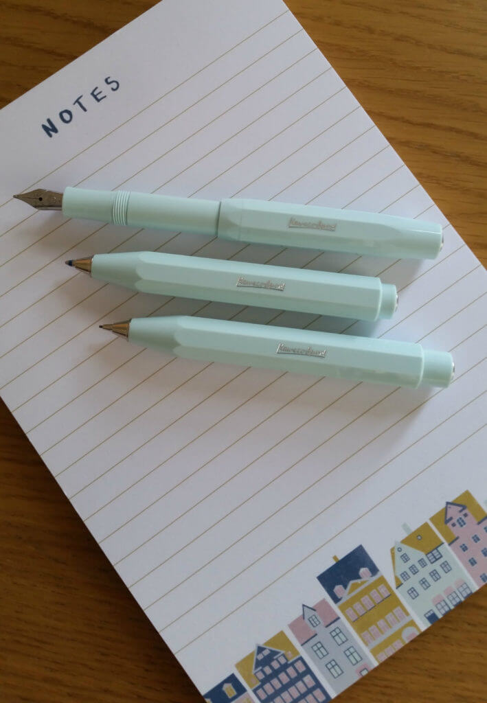 The Kaweco Skyline Sport ballpoint pen, fountain pen and mechanical pencil sat on a notepad