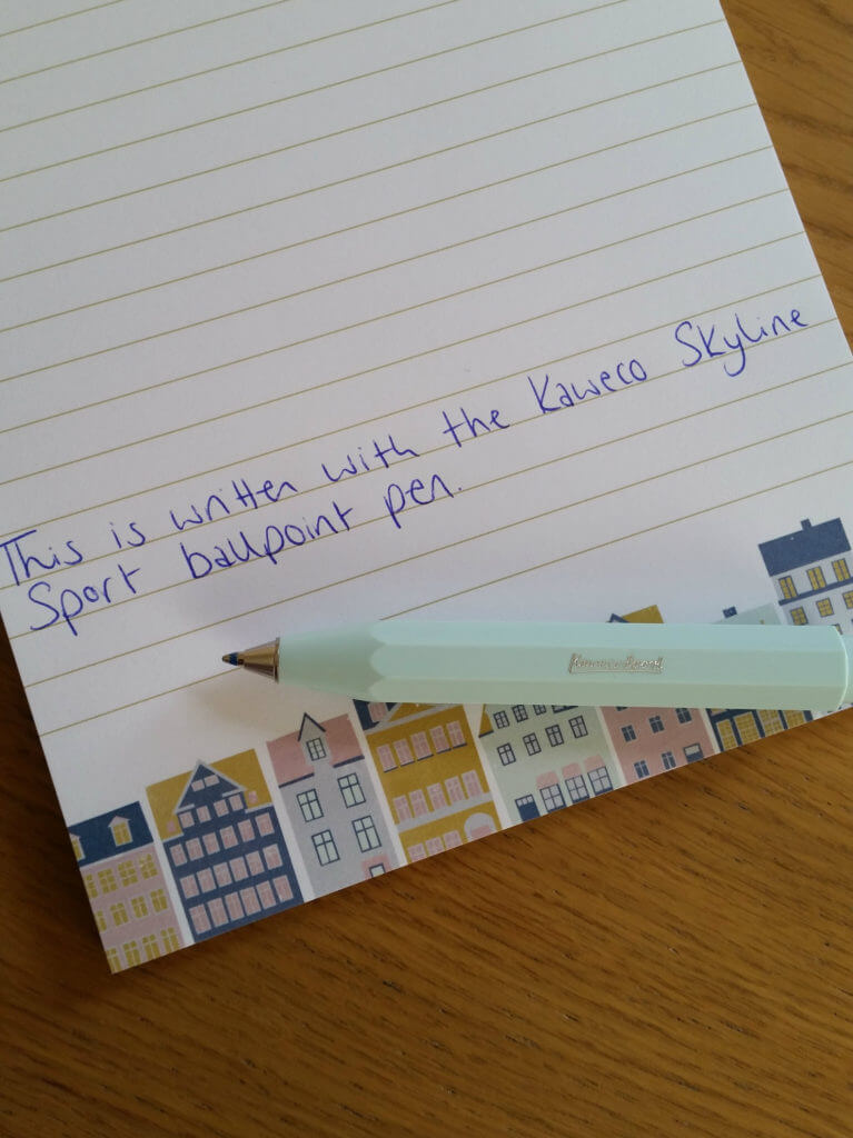 The Kaweco Skyline Sport ballpoint pen with an example of its writing