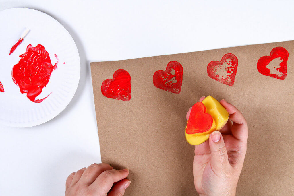 potato stamping with a heart shaped potato
