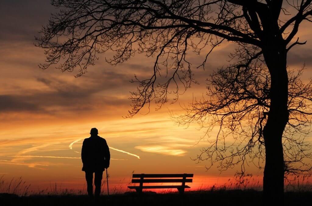 Lonely older man taking a walk