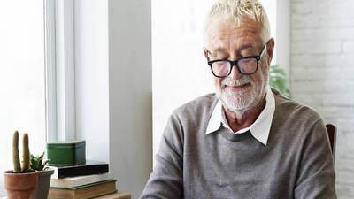 Elderly man reading coronavirus letter from neighbour
